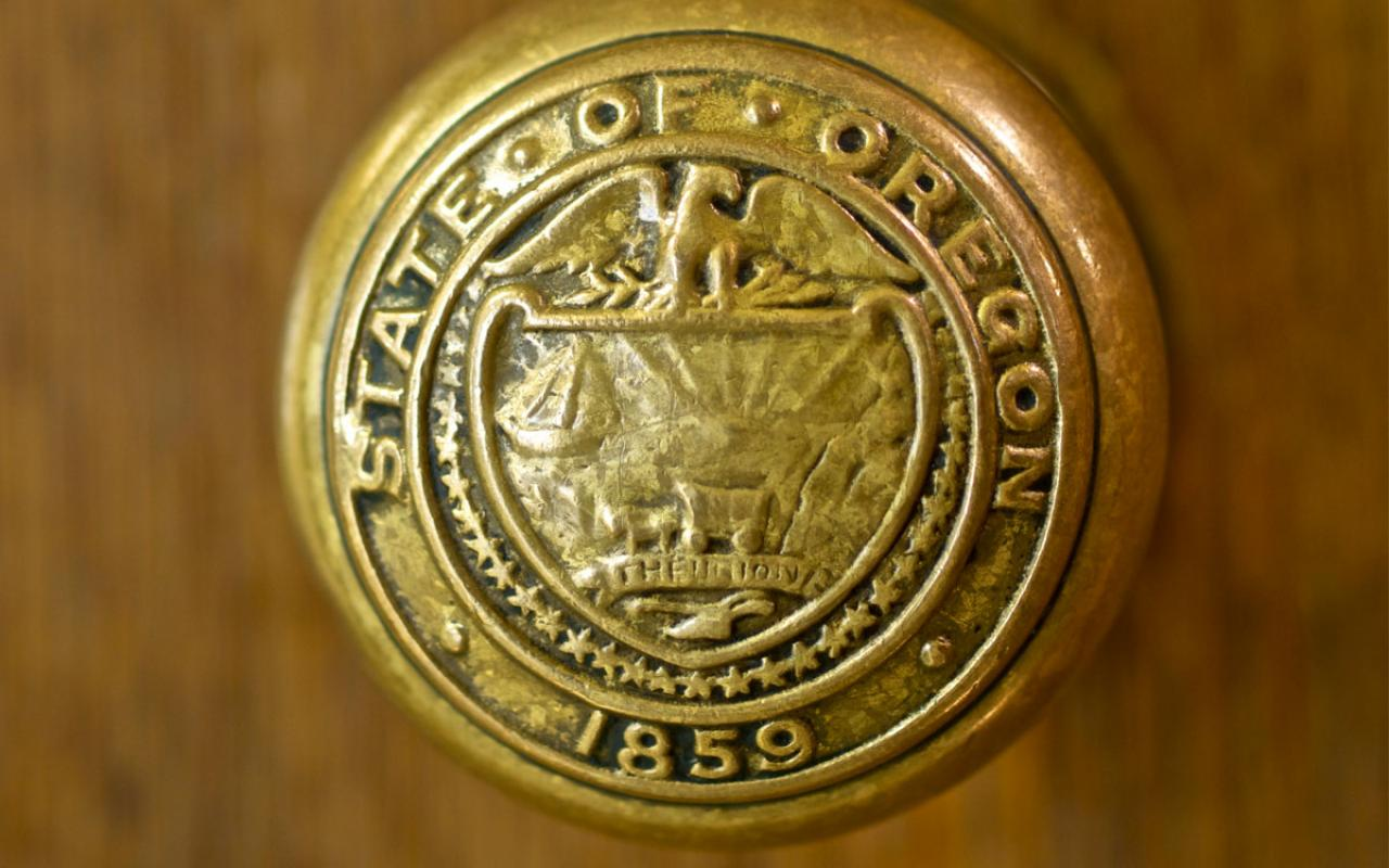 The handle of a doorknob at the Capitol building in Salem reads: State of Oregon – 1859