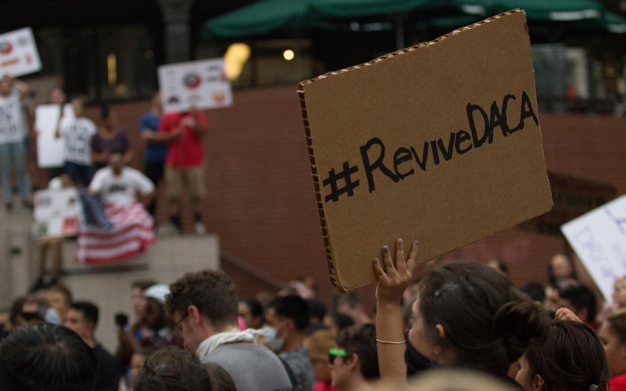 "A demonstrator at a Portland DACA rally holds a sign that reads ""Revive DACA"""