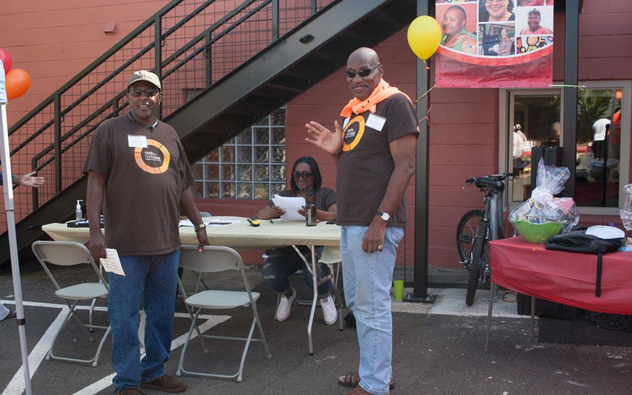 "Volunteers and staff at North by Northeast Community Health Center's community health fair, ""Health on the Corner"""