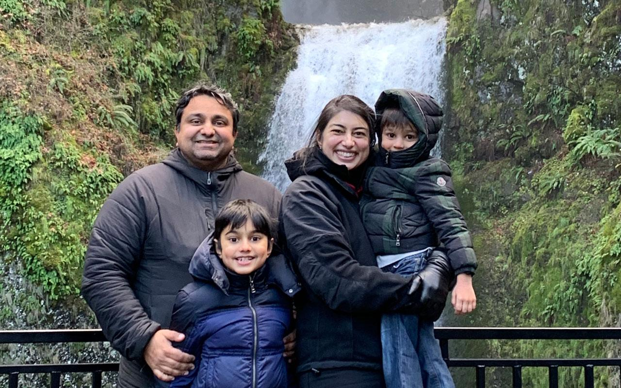 From left to right, Vikram, Vikas, Kaberi and Kavi smile for a family photo in front of Multnomah Falls.