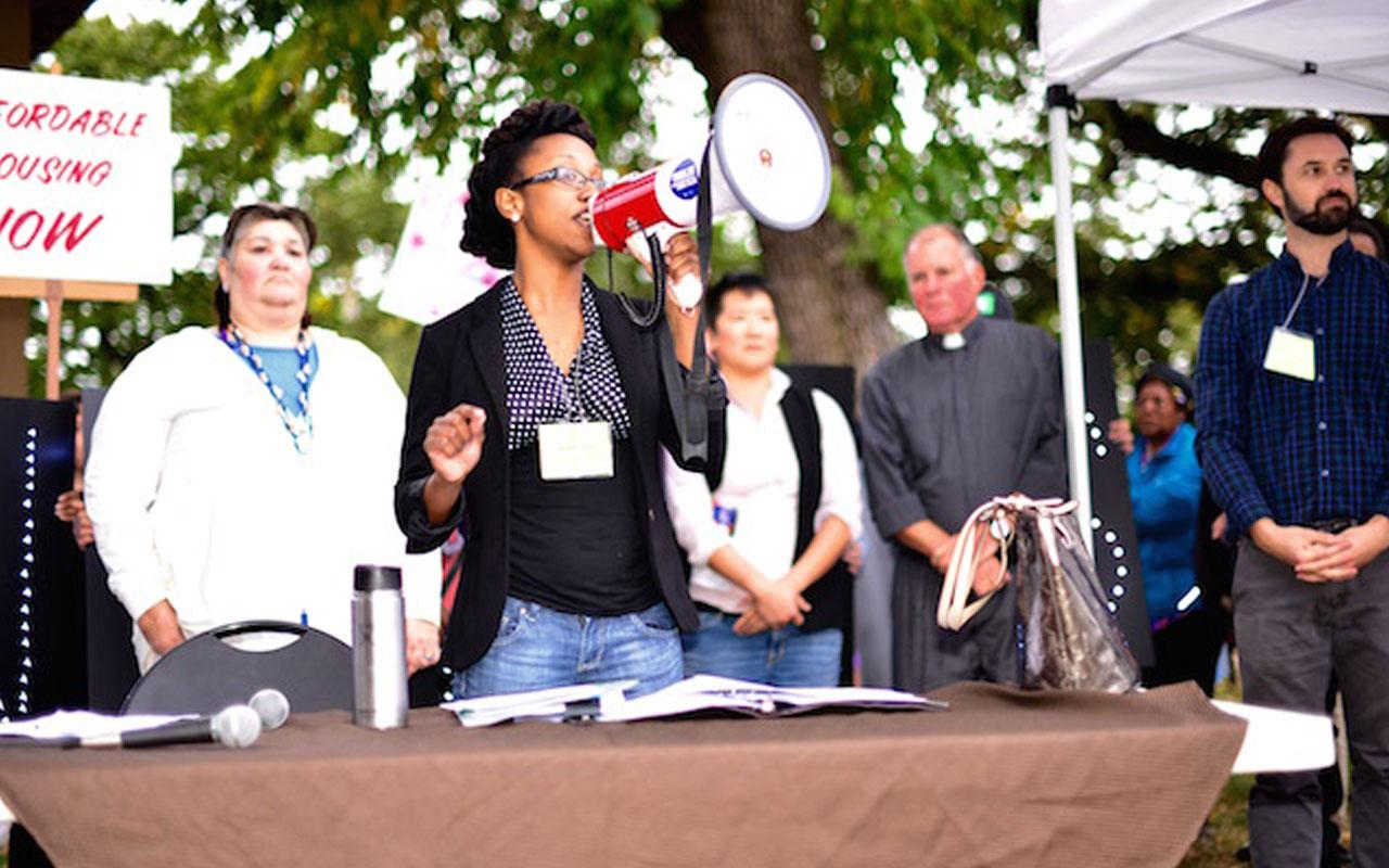 Katrina Holland, executive director of Community Alliance of Tenants, speaks at a 2016 rally for tenants' rights. Behind her, from left to right, are Jeri Jimenez, D. Pei Wu, Pastor Mark Knutson and Justin Buri.